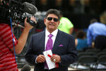 FILE - In this Aug. 8, 2015, file photo former owner of the San Francisco 49ers Edward DeBartolo, Jr., is interviewed before the Pro Football Hall of Fame ceremony at Tom Benson Hall of Fame Stadium in Canton, Ohio. President Donald Trump pardoned DeBartolo, who is convicted in gambling fraud scandal. (AP Photo/Gene J. Puskar, File)