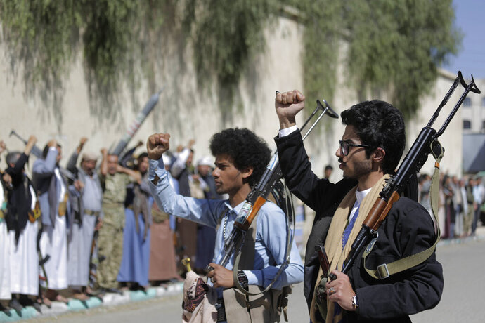 FILE - In this Feb. 25, 2020 file photo, tribesmen loyal to Houthi rebels chant slogans during a gathering aimed at mobilizing more fighters for the Houthi movement in Sanaa, Yemen. Aid organizations are making an urgent plea for donations to shore up their operations in war-torn Yemen, saying they've already been forced to stop some of their work even as the coronavirus rips through the country. The calls for funds come ahead of a UN donor conference, hosted virtually by Saudi Arabia, scheduled to take place Tuesday, June 2, 2020. (AP Photo/Hani Mohammed, File)