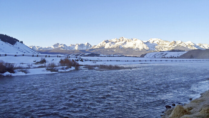 FILE - In this April 7, 2016, file photo, the Salmon River flows through the Sawtooth Valley near the town of Stanley, Idaho. The U.S. Forest Service has agreed to complete environmental reviews of 20 water diversions in central Idaho that a conservation group says could be harming imperiled salmon. A U.S. District judge on Thursday, Nov. 21, 2019, signed off on the agreement between the Forest Service and Idaho Conservation League involving the water diversions in the Sawtooth Valley. (AP Photo/Keith Ridler, File)