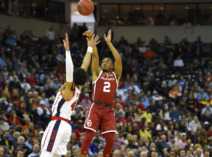 Oklahoma's Aaron Calixte (2) shoots a jumper while defended by Mississippi's Breein Tyree (4) during a first round men's college basketball game in the NCAA Tournament in Columbia, S.C. Friday, March 22, 2019. (AP Photo/Richard Shiro)