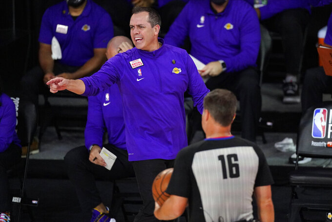 Los Angeles Lakers head coach Frank Vogel argues a call during the first half in Game 6 of basketball's NBA Finals against the Miami Heat Sunday, Oct. 11, 2020, in Lake Buena Vista, Fla. (AP Photo/Mark J. Terrill)