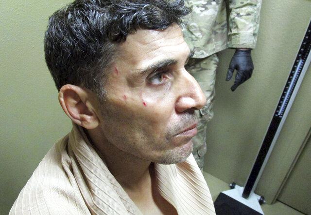 FILE - This undated image provided by the FBI in a U.S. District Court filing in Washington on Feb. 29, 2019, shows Mustafa al-Imam after his capture in October 2017.  A federal judge has sentenced Mustafa al-Imam to 19 years in federal prison for helping to plan the 2012 attacks in Benghazi. The sentence came several months after a federal jury in Washington  convicted Mustafa al-Imam of supporting the extremist militia that launched the fiery assaults on the U.S. compounds. (FBI via AP)