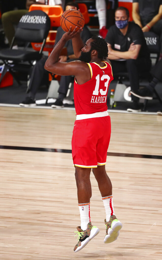 Houston Rockets guard James Harden (13) shoots a three-point basket against the Indiana Pacers in the second half of an NBA basketball game Wednesday, Aug. 12, 2020, in Lake Buena Vista, Fla. (Kim Klement/Pool Photo via AP)