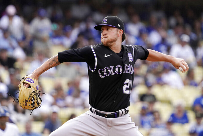 Colorado Rockies starting pitcher Kyle Freeland throws to the plate during the first inning of a baseball game against the Los Angeles Dodgers Saturday, July 24, 2021, in Los Angeles. (AP Photo/Mark J. Terrill)