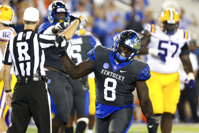 Kentucky defensive tackle Octavious Oxendine (8) celebrates getting a sack during the first half of the team's NCAA college football game against LSU in Lexington, Ky., Saturday, Oct. 9, 2021. (AP Photo/Michael Clubb)