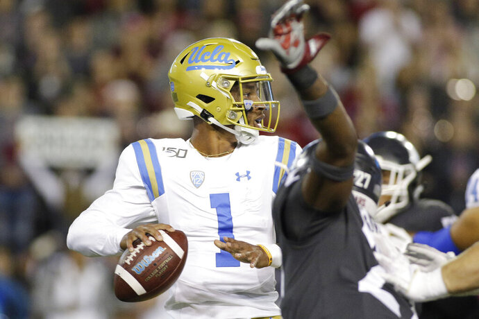 UCLA quarterback Dorian Thompson-Robinson (1) prepares to pass the ball during the first half of an NCAA college football game against Washington State in Pullman, Wash., Saturday, Sept. 21, 2019. (AP Photo/Young Kwak)