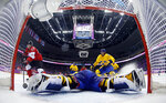 FILE - In this Feb. 23, 2014, file photo, Canada forward Sidney Crosby, left, scores a goal past Sweden goaltender Henrik Lundqvist during the second period of the men's gold medal ice hockey game at the 2014 Winter Olympics in Sochi, Russia. National Hockey League players are set to return to the Olympics in Beijing this winter after reaching an agreement with international officials. The league, NHLPA, International Olympic Committee and International Ice Hockey Federation struck a deal Friday, Sept. 3, 2021, that will put the best players in the world back on sports' biggest stage in February after skipping the 2018 Winter Games in South Korea. (AP Photo/Julio Cortez, Pool, FIle)