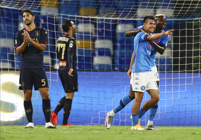 Napoli's Hirving Lozano, second from right, celebrates with Victor Osimhen after scoring his side's 4th goal during the Serie A soccer match between Napoli and Genoa at the San Paolo Stadium in Naples, Italy, Sunday, Sept. 27, 2020. (Alessandro Garofalo/LaPresse via AP)