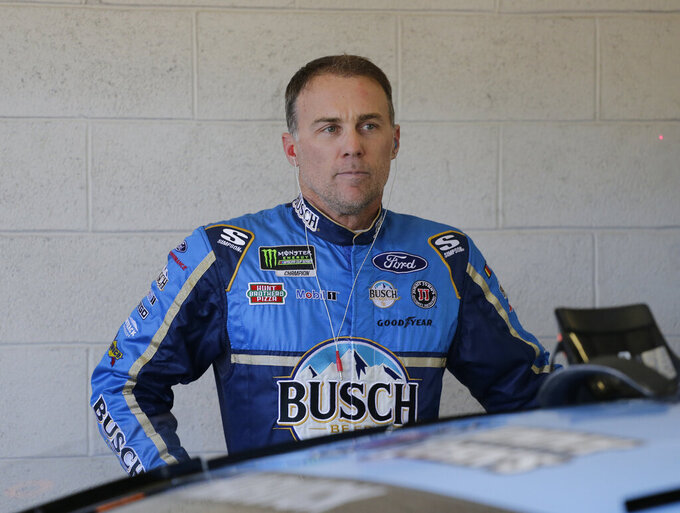 Kevin Harvick stands by his car before practice for a NASCAR Cup Series auto race on Saturday, Nov. 16, 2019, at Homestead-Miami Speedway in Homestead, Fla. Harvick is one of four drivers racing for the championship. (AP Photo/Terry Renna)