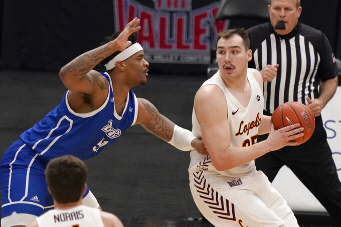 Loyola of Chicago's Cameron Krutwig, right, looks to pass as Drake's Darnell Brodie defends during the first half of the championship game in the NCAA Missouri Valley Conference men's basketball tournament Sunday, March 7, 2021, in St. Louis. (AP Photo/Jeff Roberson)