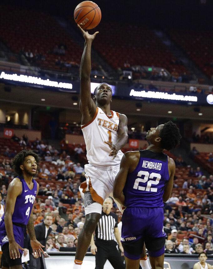 Texas guard Andrew Jones (1) shoots over TCU guard RJ Nembhard (22) during the second half of an NCAA college basketball game in Austin, Texas, Wednesday, Feb. 19, 2020. (AP Photo/Eric Gay)