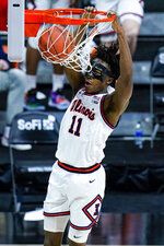 Illinois guard Ayo Dosunmu (11) dunks against Iowa in the second half of an NCAA college basketball game at the Big Ten Conference tournament in Indianapolis, Saturday, March 13, 2021. (AP Photo/Michael Conroy)