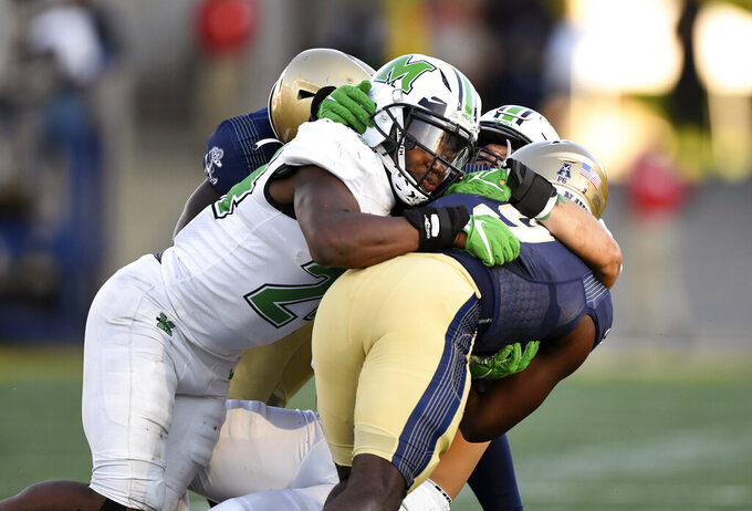 Navy quarterback Maasai Maynor (9) is sacked by Marshall linebacker Eli Neal (24) during the second half of an NCAA college football game, Saturday, Sept. 4, 2021, in Annapolis, Md. (AP Photo/Terrance Williams)