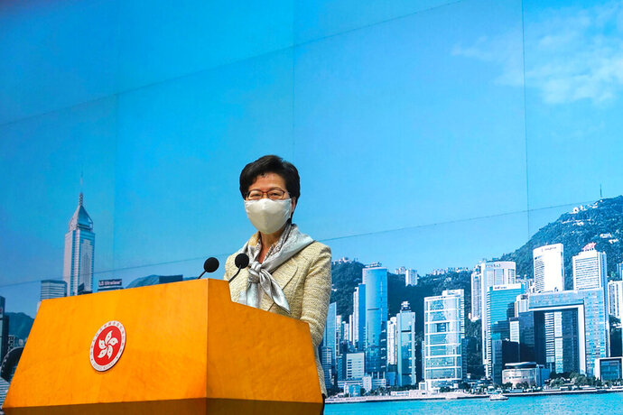 "Hong Kong Chief Executive Carrie Lam listens to reporters' questions during a press conference in Hong Kong, Tuesday, June 30, 2020. Hong Kong media are reporting that China has approved a contentious law that would allow authorities to crack down on subversive and secessionist activity in Hong Kong, sparking fears that it would be used to curb opposition voices in the semi-autonomous territory. Lam declined to comment on the national security law at a weekly meeting with reporters, saying it was ""inappropriate"" for her to do so while the Standing Committee meeting was still in progress.(AP Photo/Vincent Yu)"