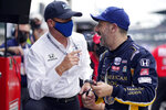 Tony Kanaan, right, of Brazil, talks with a crew member during practice for the Indianapolis 500 auto race at Indianapolis Motor Speedway, Thursday, May 20, 2021, in Indianapolis. (AP Photo/Darron Cummings)