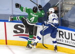 Tampa Bay Lightning center Cedric Paquette (13) checks Dallas Stars defenseman Miro Heiskanen (4) during the second period of Game 3 of the NHL hockey Stanley Cup Final, Wednesday, Sept. 23, 2020, in Edmonton, Alberta. (Jason Franson/The Canadian Press via AP)
