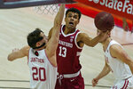 Stanford forward Oscar da Silva (13) lays up the ball as Utah forward Mikael Jantunen (20) defends in the first half during an NCAA college basketball game Thursday, Jan. 14, 2021, in Salt Lake City. (AP Photo/Rick Bowmer)