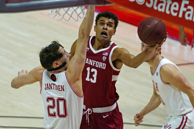 Stanford forward Oscar da Silva (13) lays up the ball as Utah forward Mikael Jantunen (20) defends in the first half during an NCAA college basketball game Thursday, Jan. 14, 2021, in Salt Lake City. (AP Photo/Rick Bowmer)