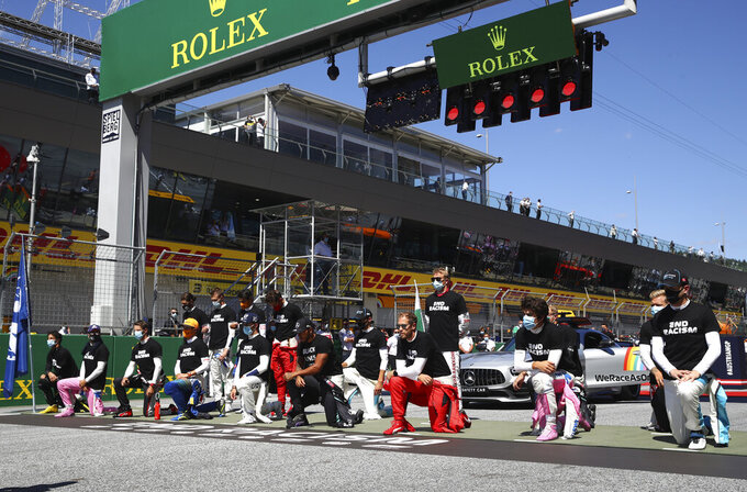 Drivers take a knee in support of the Black Lives Matter movement before the Austrian Formula One Grand Prix race at the Red Bull Ring racetrack in Spielberg, Austria, Sunday, July 5, 2020. (Dan Istitene/Pool via AP)