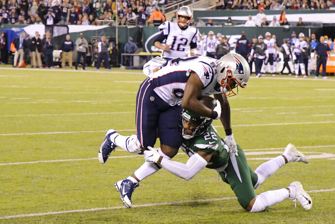 New York Jets' Trumaine Johnson (22) tackles New England Patriots' Benjamin Watson (84) during the first half of an NFL football game Monday, Oct. 21, 2019, in East Rutherford, N.J. (AP Photo/Bill Kostroun)