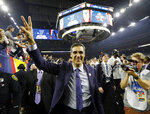 FILE - In this April 4, 2016, file photo, Villanova head coach Jay Wright celebrates after the NCAA Final Four tournament college basketball championship game against North Carolina, in Houston. (AP Photo/David J. Phillip, File)
