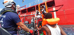 Rescued migrants are helped boarding the Ocean Viking ship, operated by the NGOs Sos Mediterranee and Doctors Without Borders, in the Mediterranean Sea, Tuesday, Aug. 13, 2019. More than 500 rescued migrants are stuck in the Mediterranean on two NGO boats, as Italy and Malta continue to deny them access to their ports. French charity group Doctors Without Borders (MSF) said late Monday in a tweet that it had completed