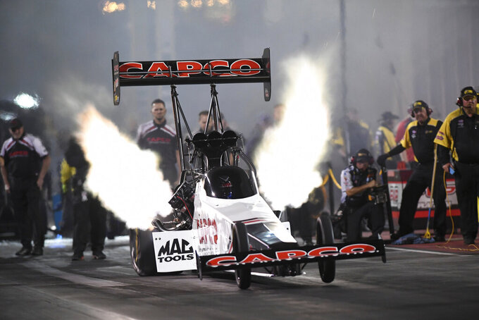 In this photo provided by the NHRA,  Steve Torrence drives in Top Fuel qualifying Saturday, July 20, 2019, for the Dodge Mile-High NHRA Nationals drag races at Bandimere Speedway in Morrison, Colo. (Jerry Foss/NHRA via AP)