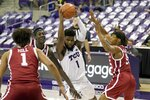 Oklahoma's Jalen Hill (1), Kur Kuath, left rear, and Alondes Williams (15) defend against a drive to the basket by TCU guard Mike Miles (1) in the second half of an NCAA college basketball game in Fort Worth, Texas, Sunday, Dec. 6, 2020. (AP Photo/Tony Gutierrez)