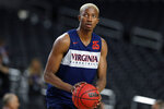 Virginia's Mamadi Diakite (25) warms up during a practice session for the semifinals of the Final Four NCAA college basketball tournament, Friday, April 5, 2019, in Minneapolis. (AP Photo/Jeff Roberson)