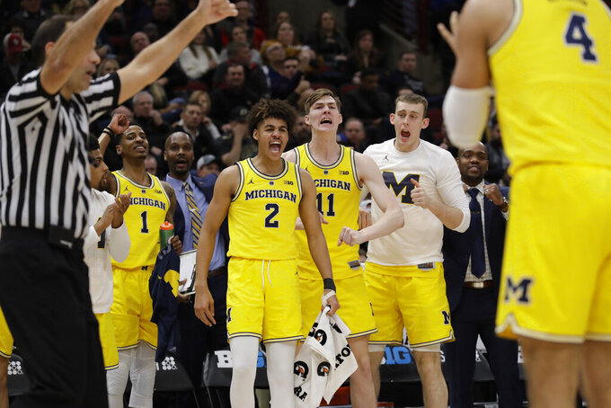 Michigan bench react to a play during the first half of an NCAA college basketball game against Iowa in the quarterfinals of the Big Ten Conference tournament, Friday, March 15, 2019, in Chicago. (AP Photo/Nam Y. Huh)