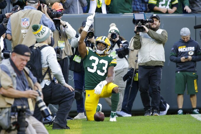 Green Bay Packers' Aaron Jones celebrates a touchdown catch during the first half of an NFL football game against the Oakland Raiders Sunday, Oct. 20, 2019, in Green Bay, Wis. (AP Photo/Jeffrey Phelps)