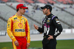 "FILE - In this March 29, 2019, file photo, Jimmie Johnson, right, chats with Joey Logano before qualifying for the NASCAR Cup Series auto race at Texas Motor Speedway in Fort Worth, Texas. The final three playoff spots are up for grabs as stock-car racing returns to the high-banked superspeedway in Daytona Beach, Fla., two weeks after running the road course. Nearly half the field is looking to clinch a postseason berth with a victory, including seven-time series champion Jimmie Johnson. ""A lot of people are desperate,"" said Team Penske driver Joey Logano, who's already locked into the playoffs. ""Crazy things will happen."" (AP Photo/LM Otero, File)"