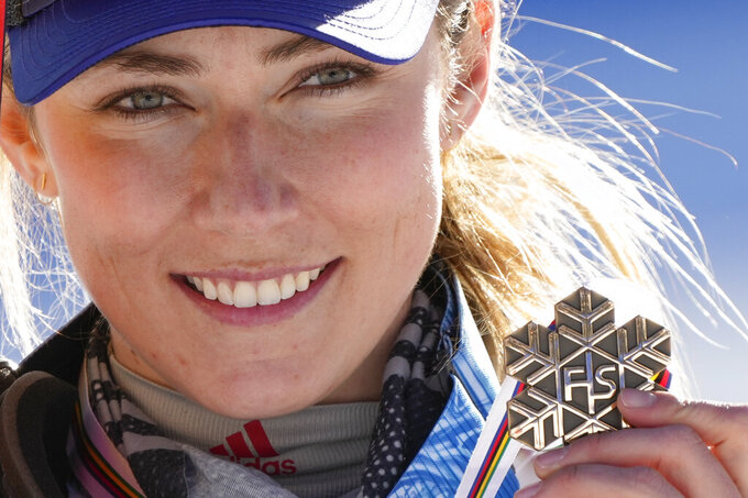United States' Mikaela Shiffrin shows her bronze medal of the women's slalom, at the alpine ski World Championships in Cortina d'Ampezzo, Italy, Saturday, Feb. 20, 2021. (AP Photo/Giovanni Auletta)