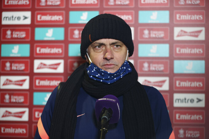 Tottenham's manager Jose Mourinho answers questions during an interview after his team's 5-0 win in the English FA Cup third round soccer match between Marine and Tottenham Hotspur at Rossett Park stadium in Crosby, Liverpool, Sunday, Jan. 10, 2021. (Clive Brunskill/Pool via AP)