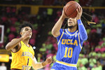 UCLA's Tyger Campbell (10) drives to the basket against Arizona State's Remy Martin (1) during the first half of an NCAA college basketball game Thursday, Feb. 6, 2020, in Tempe, Ariz. (AP Photo/Darryl Webb)
