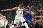 Milwaukee Bucks' Giannis Antetokounmpo and New York Knicks' Bobby Portis go after a loose ball during the first half of an NBA basketball game Tuesday, Jan. 14, 2020, in Milwaukee. (AP Photo/Morry Gash)
