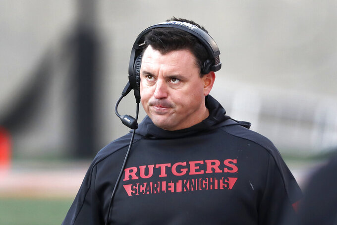 Rutgers interim head coach Nunzio Campanile looks up at the scoreboard during the second half of an NCAA college football game against Illinois, Saturday, Nov. 2, 2019, in Champaign, Ill. (AP Photo/Charles Rex Arbogast)