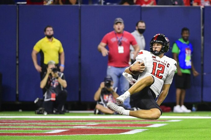 Texas Tech quarterback Tyler Shough (12) scores a touchdown against Houston during the second half of an NCAA college football game Saturday, Sept. 4, 2021, in Houston. (AP Photo/Justin Rex)