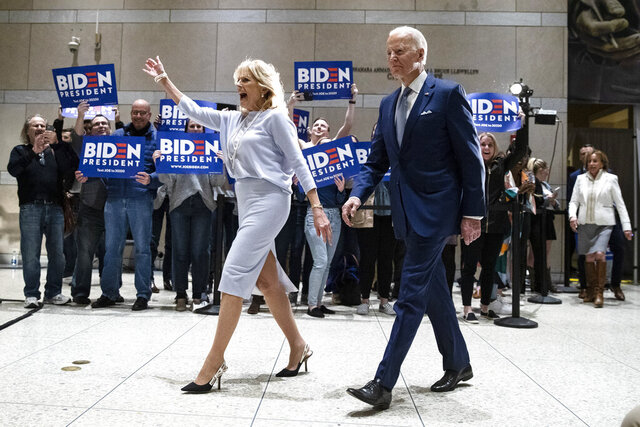 Democratic presidential candidate former Vice President Joe Biden, accompanied by his wife Jill arrives to speak to members of the press at the National Constitution Center in Philadelphia, Tuesday, March 10, 2020. (AP Photo/Matt Rourke)