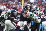 Houston Texans quarterback Deshaun Watson (4) is sacked by Carolina Panthers cornerback Javien Elliott (23) during the second half of an NFL football game Sunday, Sept. 29, 2019, in Houston. (AP Photo/Eric Christian Smith)