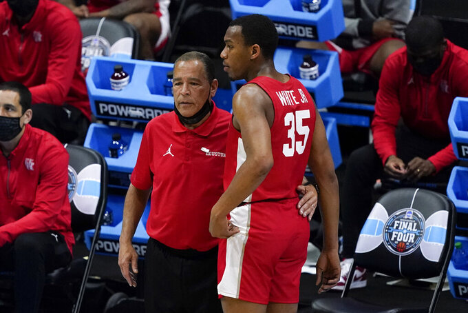 Houston head coach Kelvin Sampson talks with forward Fabian White Jr. (35) during the second half of a men's Final Four NCAA college basketball tournament semifinal game against Baylor, Saturday, April 3, 2021, at Lucas Oil Stadium in Indianapolis. (AP Photo/Darron Cummings)