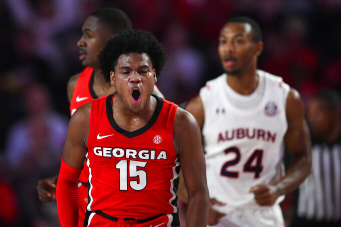 Georgia guard Sahvir Wheeler (15) reacts after scoring against Auburn during the first half of an NCAA college basketball game Wednesday, Feb. 19, 2020, in Athens, Ga. (AP Photo/John Amis)