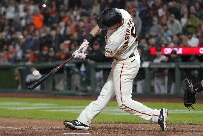 San Francisco Giants' Mike Yastrzemski hits a grand slam home run during the eighth inning of a baseball game against the Arizona Diamondbacks in San Francisco, Tuesday, June 15, 2021. (AP Photo/Jeff Chiu)