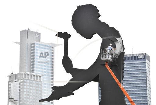 APTOPIX Germany Hammering Man