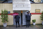 Security guards stand outside Saudi Arabia's consulate in Istanbul, Thursday, Oct. 11, 2018. Turkish officials have said they believe Saudi writer and government critic Jamal Khashoggi, was killed inside the consulate after he visited the mission to obtain a document required to marry his Turkish fiancee. (AP Photo/Lefteris Pitarakis)