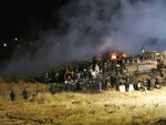 FILE - In this Nov. 20, 2016 file photo, provided by Morton County Sheriff's Department, law enforcement and protesters clash near the site of the Dakota Access pipeline on Sunday, Nov. 20, 2016, in Cannon Ball, N.D. A federal judge on Monday, July 6, 2020 sided with the Standing Rock Sioux Tribe and ordered the Dakota Access pipeline to shut down until more environmental review is done. (Morton County Sheriff's Department via AP, File)