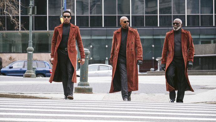 This image released by Warner Bros. Pictures shows from left, Jessie Usher, Samuel Jackson and Richard Roundtree in a scene from