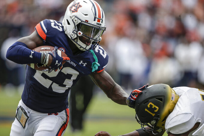 Auburn cornerback Roger McCreary (23) stiff arms Alabama State quarterback Ryan Nettles (13) after an interception as he returns it for a touchdown during the second half of an NCAA football game Saturday, Sept. 11, 2021, in Auburn, Ala. (AP Photo/Butch Dill)