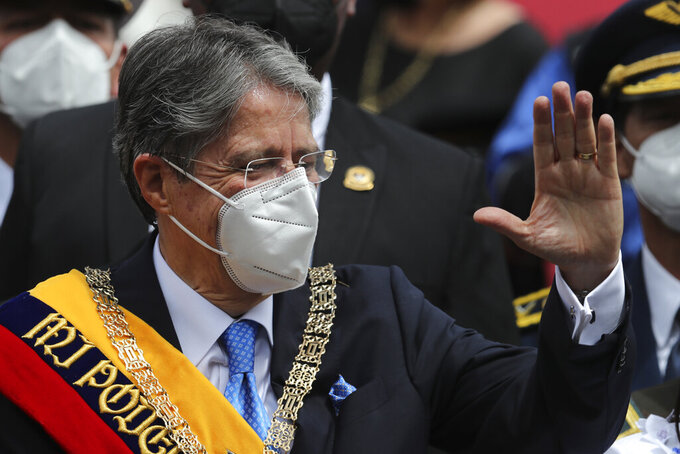 Ecuador's new President Guillermo Lasso wears the presidential sash after his inauguration ceremony outside the National Assembly in Quito, Ecuador, Monday, May 24, 2021. (AP Photo/Dolores Ochoa)