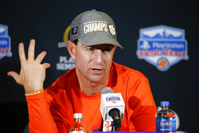 Clemson coach Dabo Swinney speaks during a news conference after the team's 29-23 win over Ohio State in the Fiesta Bowl NCAA college football playoff semifinal Saturday, Dec. 28, 2019, in Glendale, Ariz. (AP Photo/Ross D. Franklin)